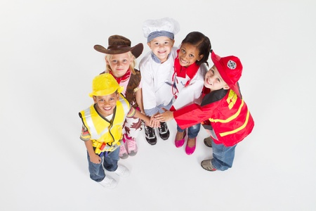 overhead view of kids in occupational uniforms teamwork Stock Photo - 9169034