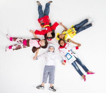group of kids in various uniforms lying on floor Stock Photo - 9168952