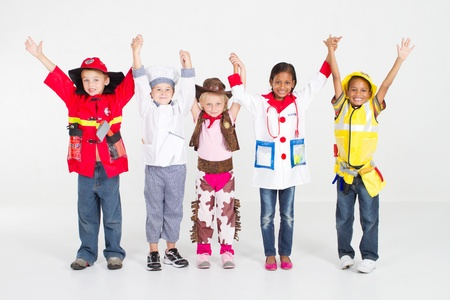 role play: cheerful group of kids in uniforms