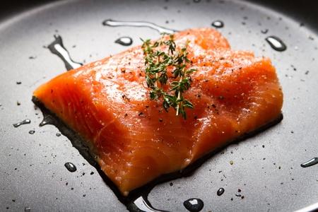 fresh raw salmon in pan photo