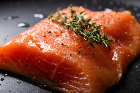 salmon steak in skillet photo