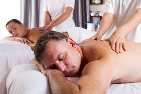 couples therapy: couple having massage in spa salon Stock Photo