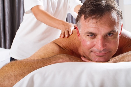 mature man having massage at spa salon photo