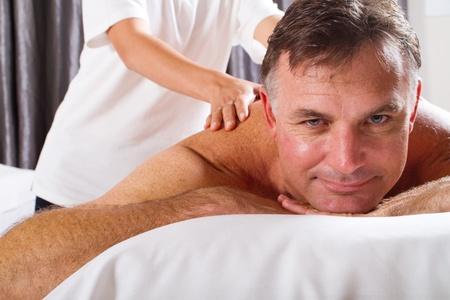 40s adult: mature man having massage at spa salon