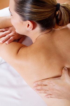 young woman receiving back massage photo