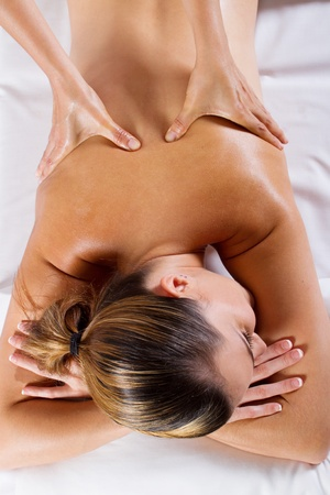 young woman receiving back massage Stock Photo - 9526522