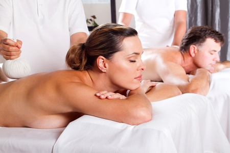 beauty parlour: man and woman having Thai massage Stock Photo