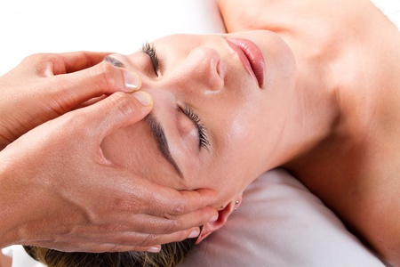 pretty young woman receiving a head massage  photo