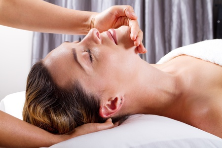 pretty young woman receiving a head massage Stock Photo - 9526547