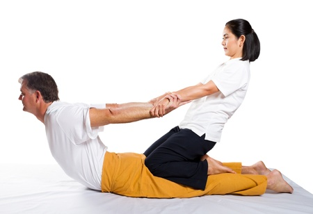 middle aged man receiving thai massage photo