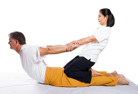 shiatsu: middle aged man receiving thai massage
