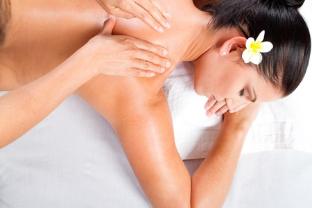 spa face: young woman receiving back massage