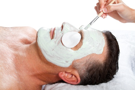 male facial: middle age man with facial mask in beauty salon Stock Photo