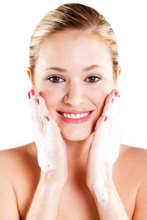 cheek to cheek: Beautiful caucasian woman washing her face with foam