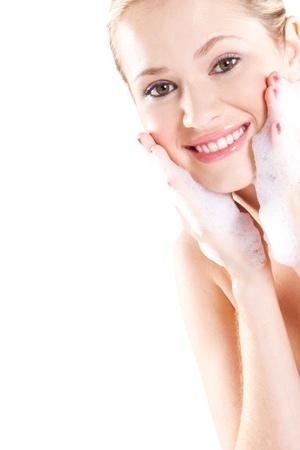 Beautiful caucasian woman washing her face with foam Stock Photo - 9771924
