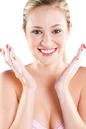 happy beautiful young woman face wash photo