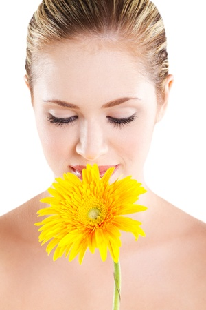 beautiful young woman smelling flower on white photo