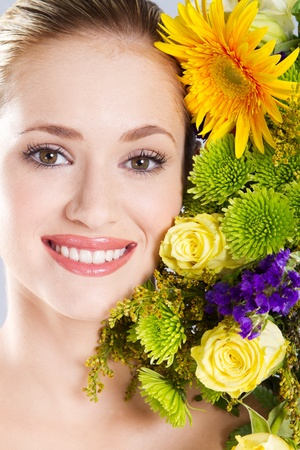 attractive smiling woman portrait with flowers photo
