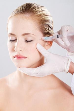 botox: Botox shot in the female face