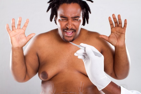 plastic glove: scary cosmetic surgery Stock Photo