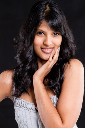 beautiful young indian woman portrait on black background Stock Photo - 9844260