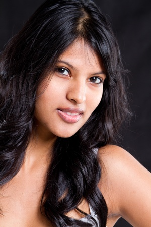 smart girl: beautiful young indian woman portrait on black background