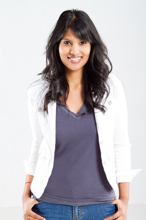 cheerful young indian woman portrait over white photo