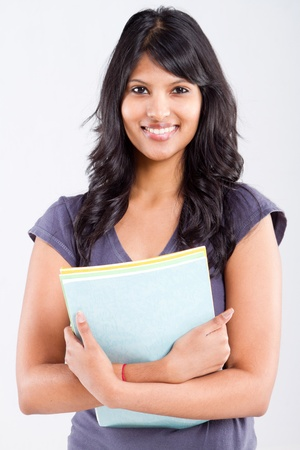 cute indian university student holding books photo