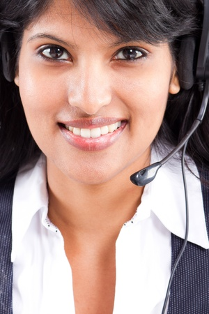 young indian business woman or telephone operator with headset photo