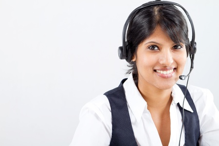 customer assistant: young indian business woman or telephone operator with headset Stock Photo