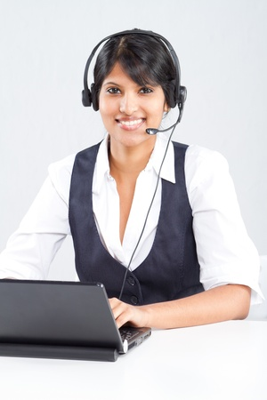 happy indian call center operator with headset photo