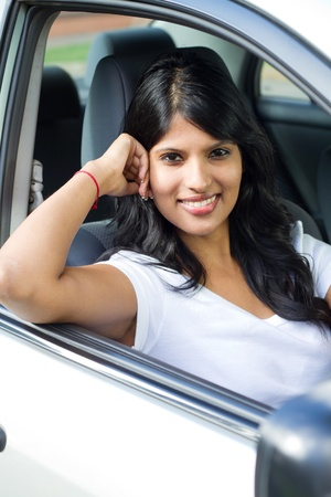 beautiful young female driver inside a car photo