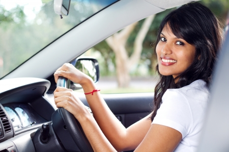 young indian woman driving a car photo