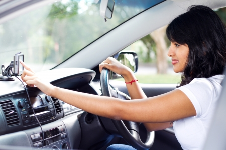 female driver using GPS navigator photo