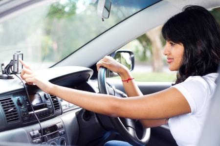 navigation panel: female driver using GPS navigator Stock Photo