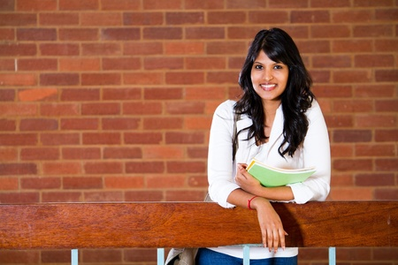 indian college student: female university student inside campus building Stock Photo