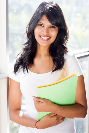 beautiful indian girl face: pretty university student standing by glass window