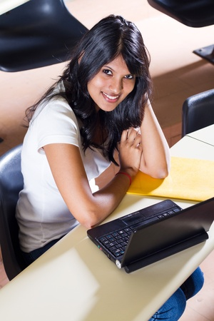 happy female college student in classroom photo