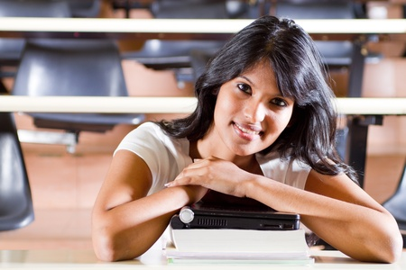 Female college student in university lecture room photo