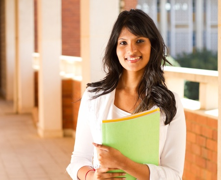 beautiful young college student in school building photo