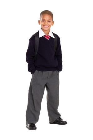full uniform: full length studio portrait of male elementary pupil on white