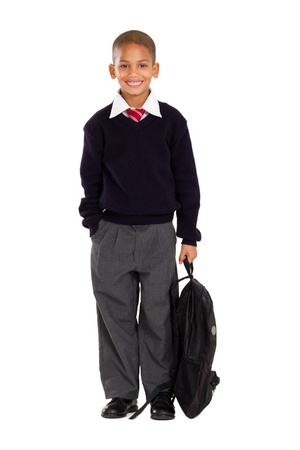 full length studio portrait of male elementary pupil on white photo
