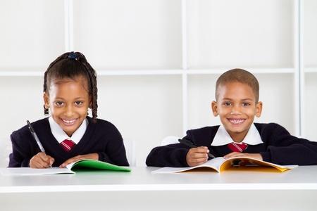 school uniform girl: happy primary students portrait