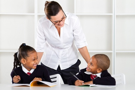 elementary teacher talking to pupils in classroom Stock Photo - 10747027