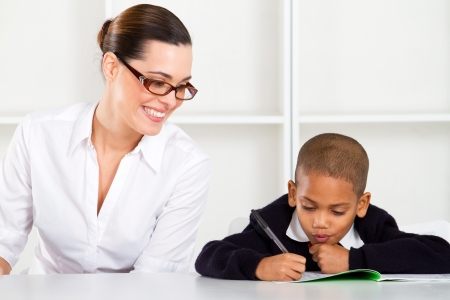 tutoring: happy primary school teacher and pupil Stock Photo
