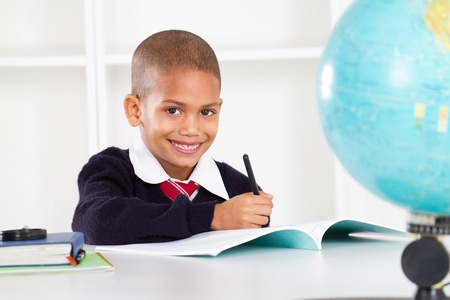 happy primary school boy in classroom Stock Photo - 10746867