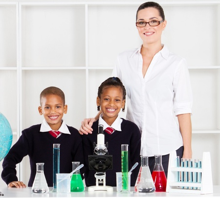 portrait of primary teacher and students in science class photo