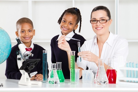 primary school students and teacher in science class photo