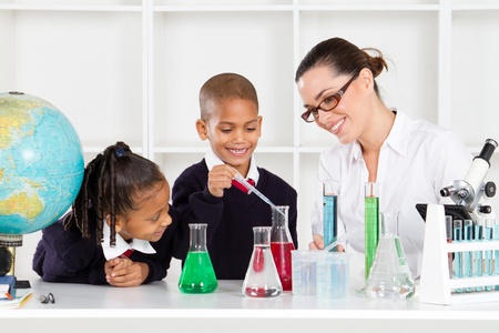 science teacher and students in lab Stock Photo - 10746674