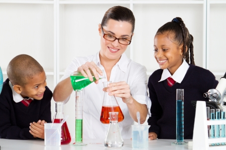 science teacher teaching students in lab Stock Photo - 10746930